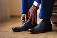 Businessman clothes shoes, Politician, man`s style, Businessman. Buttoning his shirt,male hands closeup, American, European businessman, People, business Royalty Free Stock Image