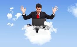 Businessman on a cloud Stock Photography