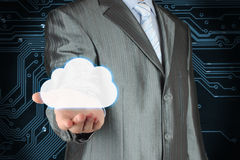 Businessman with cloud on dark circuit board background Royalty Free Stock Image