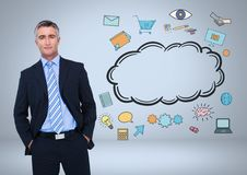 Businessman with cloud and online business graphic drawings Stock Photos