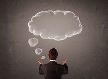 Businessman with cloud thought above his head Stock Photo