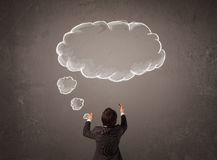 Businessman with cloud thought above his head Royalty Free Stock Photo