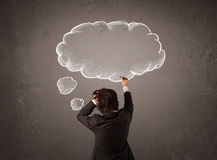 Businessman with cloud thought above his head Royalty Free Stock Photos