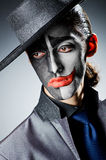 Businessman with clown  paint Stock Photo