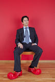 Businessman with clown shoes Stock Photos