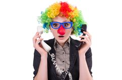 Businessman with clown wig isolated on the white Stock Images