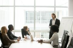 Businessman coach giving presentation to multiracial partners at royalty free stock photos