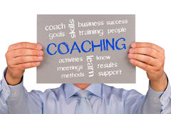 Businessman with coaching sign Stock Photo