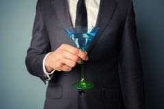 Businessman with cocktail glass Royalty Free Stock Image