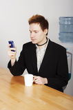 Businessman with coffee Stock Images