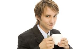 Businessman with coffee. Businessman holds a cup of coffee and smiles Royalty Free Stock Photo