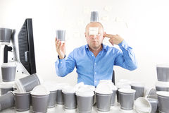 Businessman with coffee addiction Royalty Free Stock Image