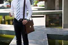 Businessman with coffee and briefcase stock photo