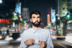 Businessman with coffee in city Royalty Free Stock Image