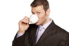 Businessman with Coffee Cup. Smiling Businessman with Coffee Cup on White Background royalty free stock photos