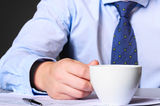Businessman with coffee Royalty Free Stock Photo