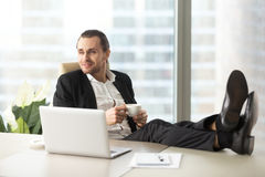 Businessman with coffee imagines happy future Stock Image