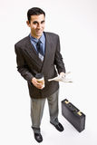 Businessman with coffee and newspaper Stock Images