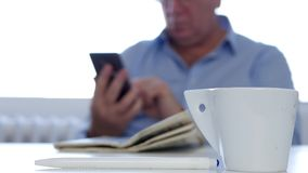 Businessman with Coffee and Newspaper Texting Using Cellphone Wirelesses Network.  stock footage