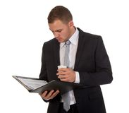 Businessman with coffee while reading documents Royalty Free Stock Photos