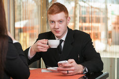 Businessman drinking coffee. A businessman coffee time and he drinks coffee Stock Images