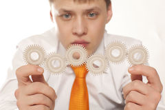 Businessman with cogwheel Royalty Free Stock Image