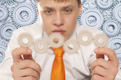 Businessman with cogwheel Stock Photos