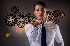 The businessman with cogwheels gear in teamwork concept. Businessman with cogwheels gear in teamwork concept Royalty Free Stock Images