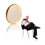 Businessman with a coin stock photo