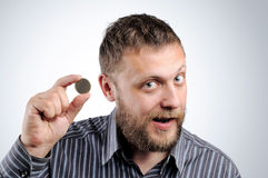 Businessman with a coin. Royalty Free Stock Photography