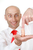 Businessman with coins. Businessman pointing at the stack of coins on his hand royalty free stock photography