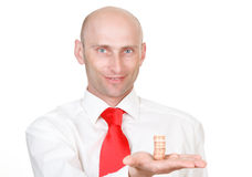 Businessman with coins. Portrait of smiling bald headed young businessman with pile of coins in hand, isolated on white background royalty free stock photos