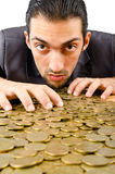 Businessman with   coins Stock Image