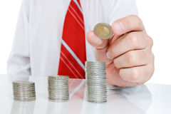 Businessman with coins Royalty Free Stock Image