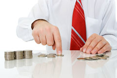 Businessman with coins Stock Photos