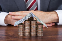 Businessman With Coins And Banknote House On Desk Stock Image