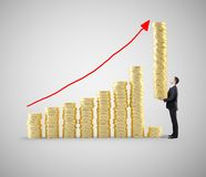 Businessman with coins. Businessman with tower of coins building chart coins Royalty Free Stock Photos