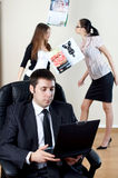 Businessman with collaborator on backside. Businessman with laptop sit in an armchair with collgues on backside royalty free stock image