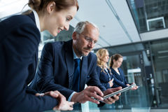 Businessman with colleague using digital tablet Royalty Free Stock Images