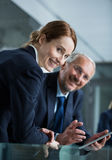 Businessman with colleague using digital tablet Stock Photography