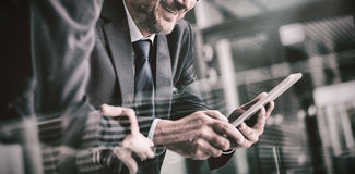 Businessman with colleague using digital tablet Stock Photos