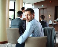 Businessman with colleagues in background Stock Photography