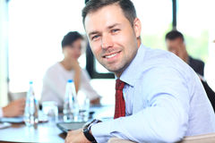 Businessman with colleagues in background Stock Photo
