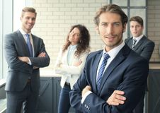 Businessman with colleagues in the background in office. Stock Photo