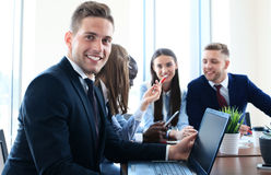 Businessman with colleagues Stock Image