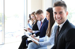 Businessman with colleagues Stock Photo