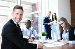 Businessman with colleagues Royalty Free Stock Photo