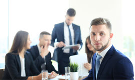 Businessman with colleagues Royalty Free Stock Image