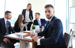 Businessman with colleagues Royalty Free Stock Photos