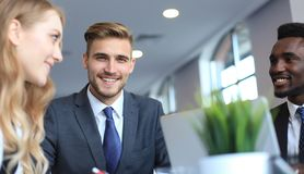 Businessman with colleagues in the background in office. Businessman with colleagues in the background in office Royalty Free Stock Image